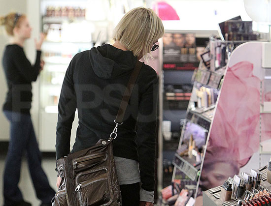 Guess Who's Checking Out the Cosmetics Counter?