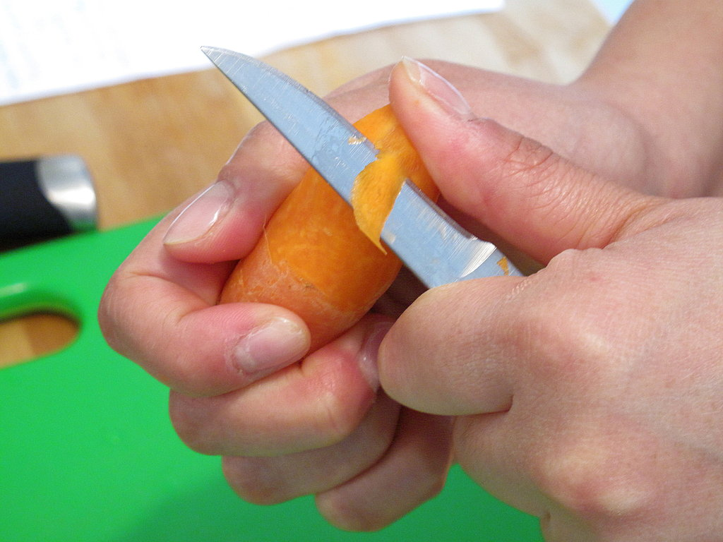 Keeping your knife steady, turn the vegetable as you go, forming a gentle arc. The classic turned vegetable has a seven-sided shape, so ideally, you will want to repeat the peeling process six more times.
