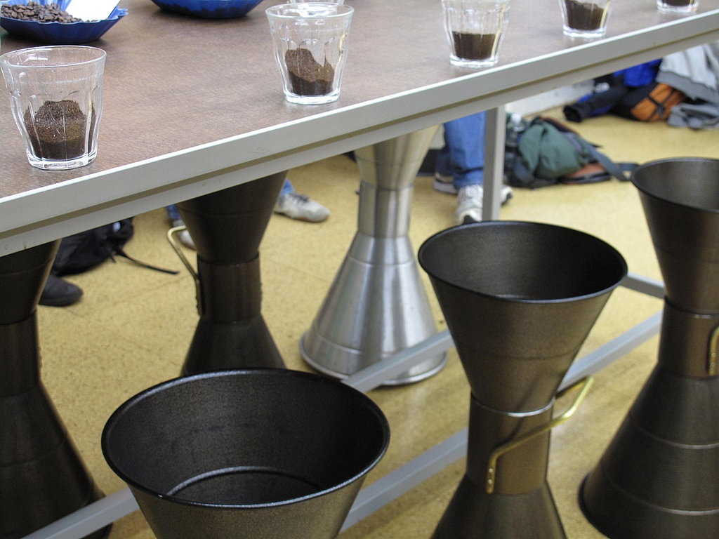 Spittoons for the already-tasted coffee.