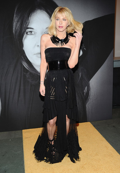 Courtney Love subtly showed off her legs in a sheer black Givenchy gown and tribal necklace.