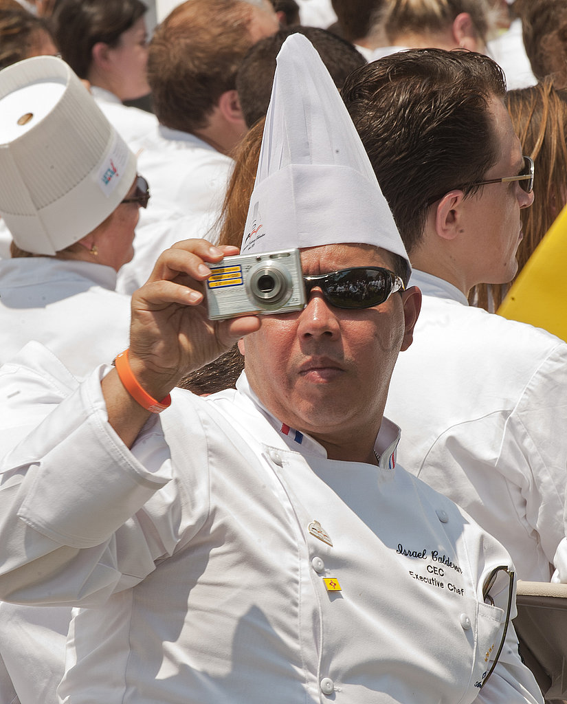 Chef Israel Calderon snapping photos as Michelle Obama delivers her remarks on the new program.