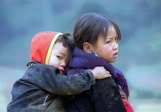 Children Carrying Siblings