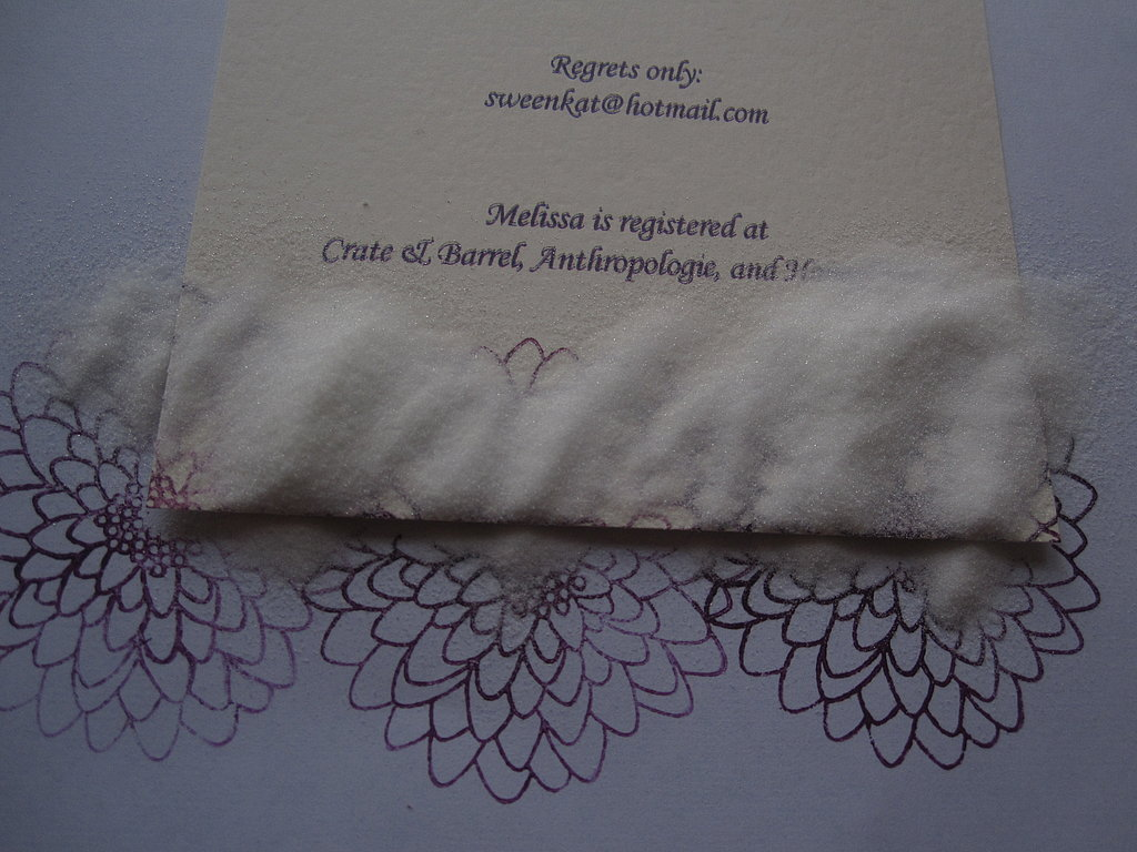 Working quickly, cover the stamped part with embossing powder. Tap the extra powder off.