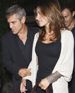 Pictures of George Clooney and Elisabetta Canalis at LAX