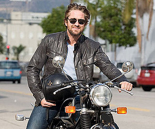 Slide Picture of Gerard Butler Driving a Motorcycle in LA