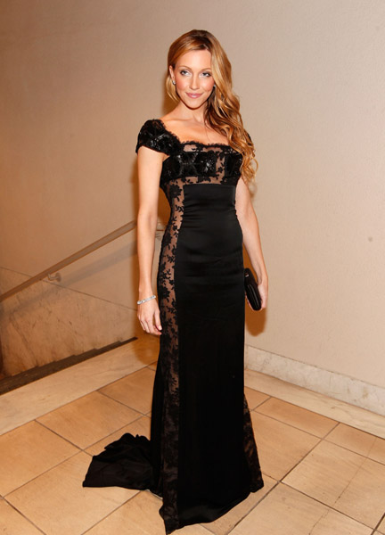 Katie Cassidy went totally femme in a lacy, black floor-length gown.