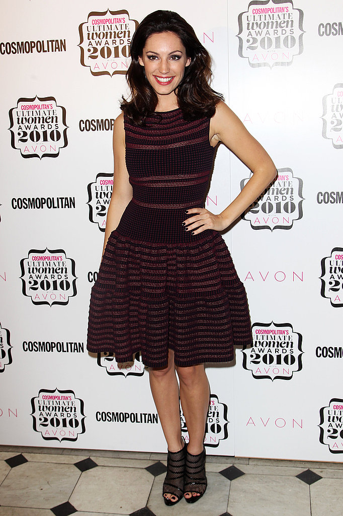 Kelly Brook in striped Alaia and strappy heels.