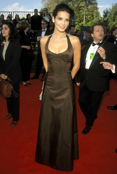Angie Harmon kept it simple in a floor-length halter gown in '99.