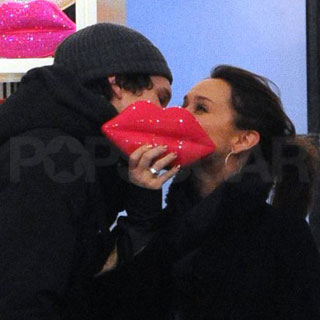 Guess Who's Puckering Up to Kiss Her Man?