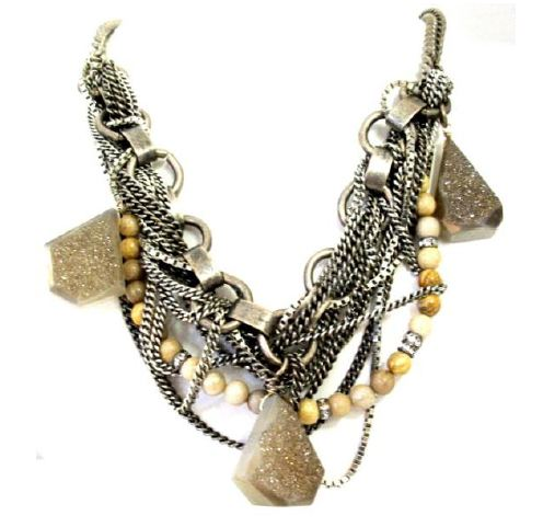 This Camilla James necklace ($495) is like a beachy glam version of treasure with the beads and glittering stone, all wrapped up in severe chains.