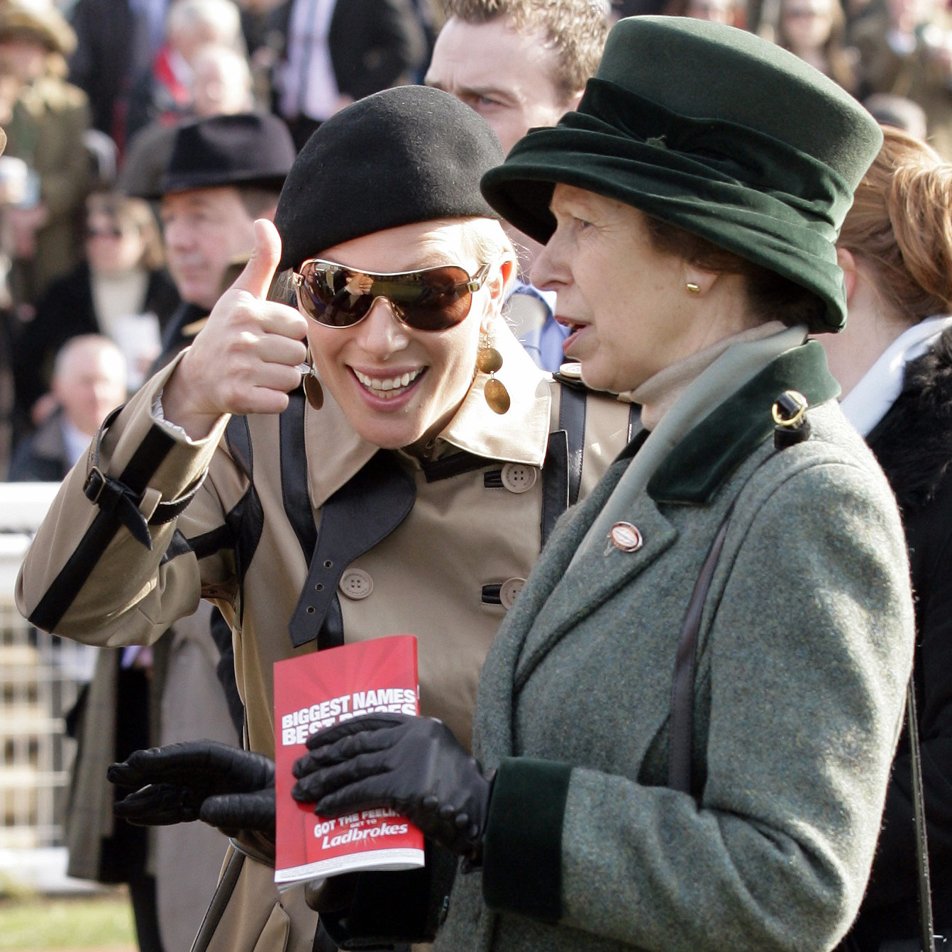 Zara gave a thumbs-up as she watched a horse race with her mom, Anne, Princess Royal, in March of 2012.