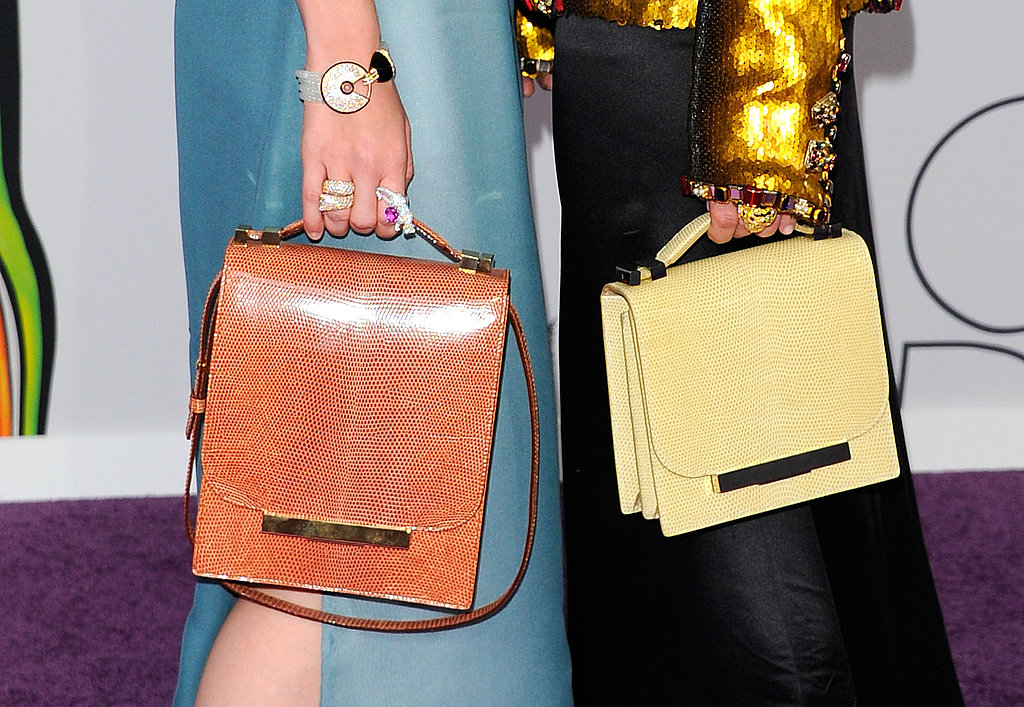 Swarovski Womenswear nominees Mary-Kate and Ashley Olsen toted bags from The Row's Resort 2012 line, giving a peek at the collection which has yet to be revealed. They also wore $575,000 and $570,000 worth of Cartier jewelry, respectively.