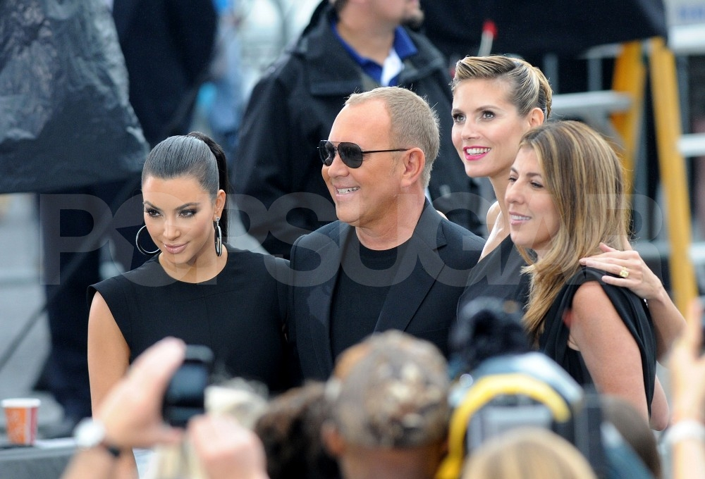 Heidi Klum, Nina Garcia, Kim Kardashian, and Michael Kors posed for a group photo on the Project Runway set.