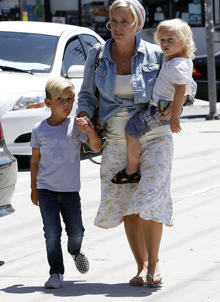 Kingston and Zuma Rossdale walk with a nanny.