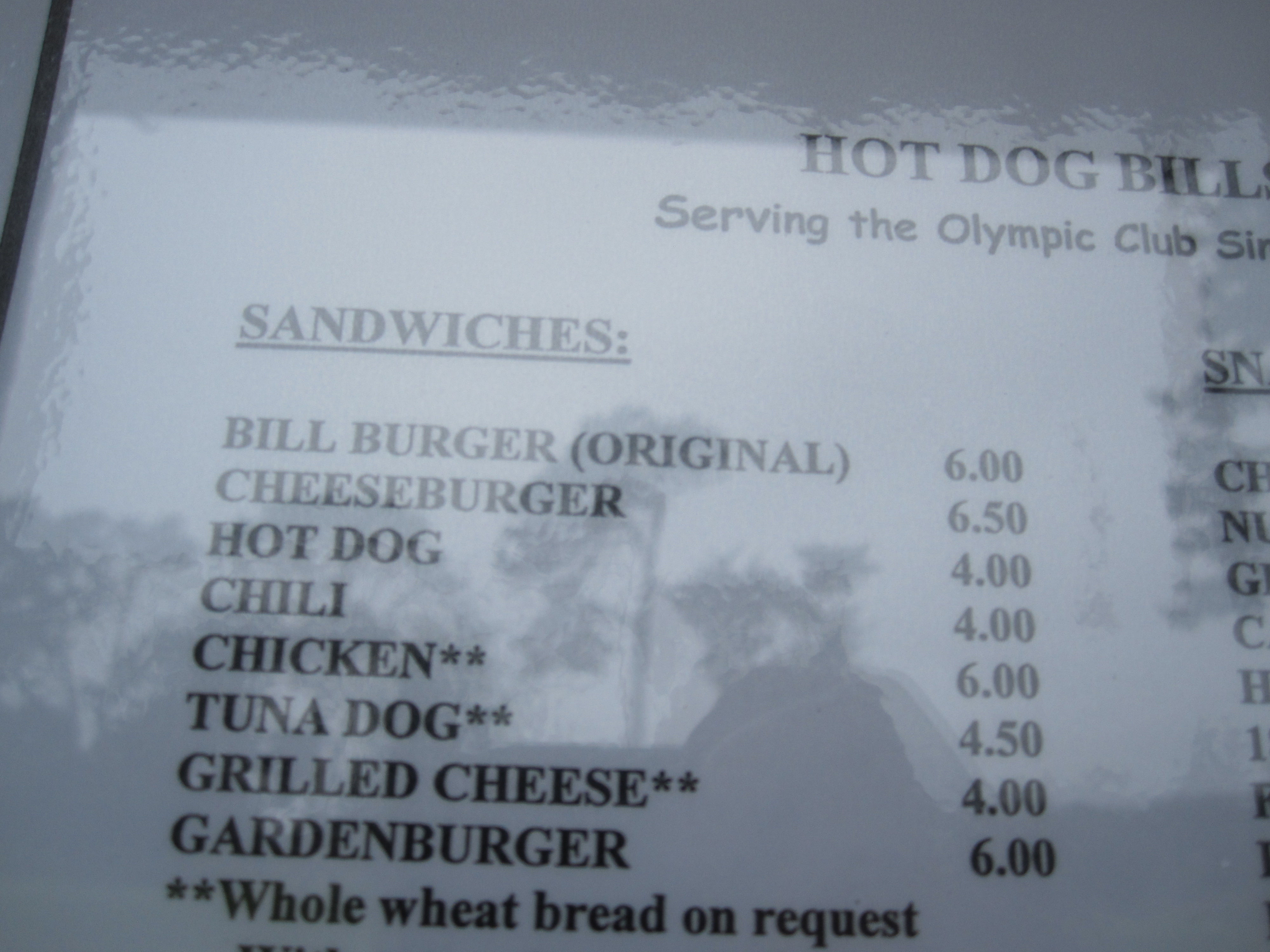 The Bill Burger was created in the 1950s by Bill Parish. He opened a trailer outside of the Olympic Club and served golfers hot dogs and hamburgers. Since he didn't want to pay for two different kinds of buns, he made a burger in the shape of a hot dog, and served it in a hot dog bun. The burgers became so popular among the golfers that the Olympic Club invited Bill inside to set up shop along the course.