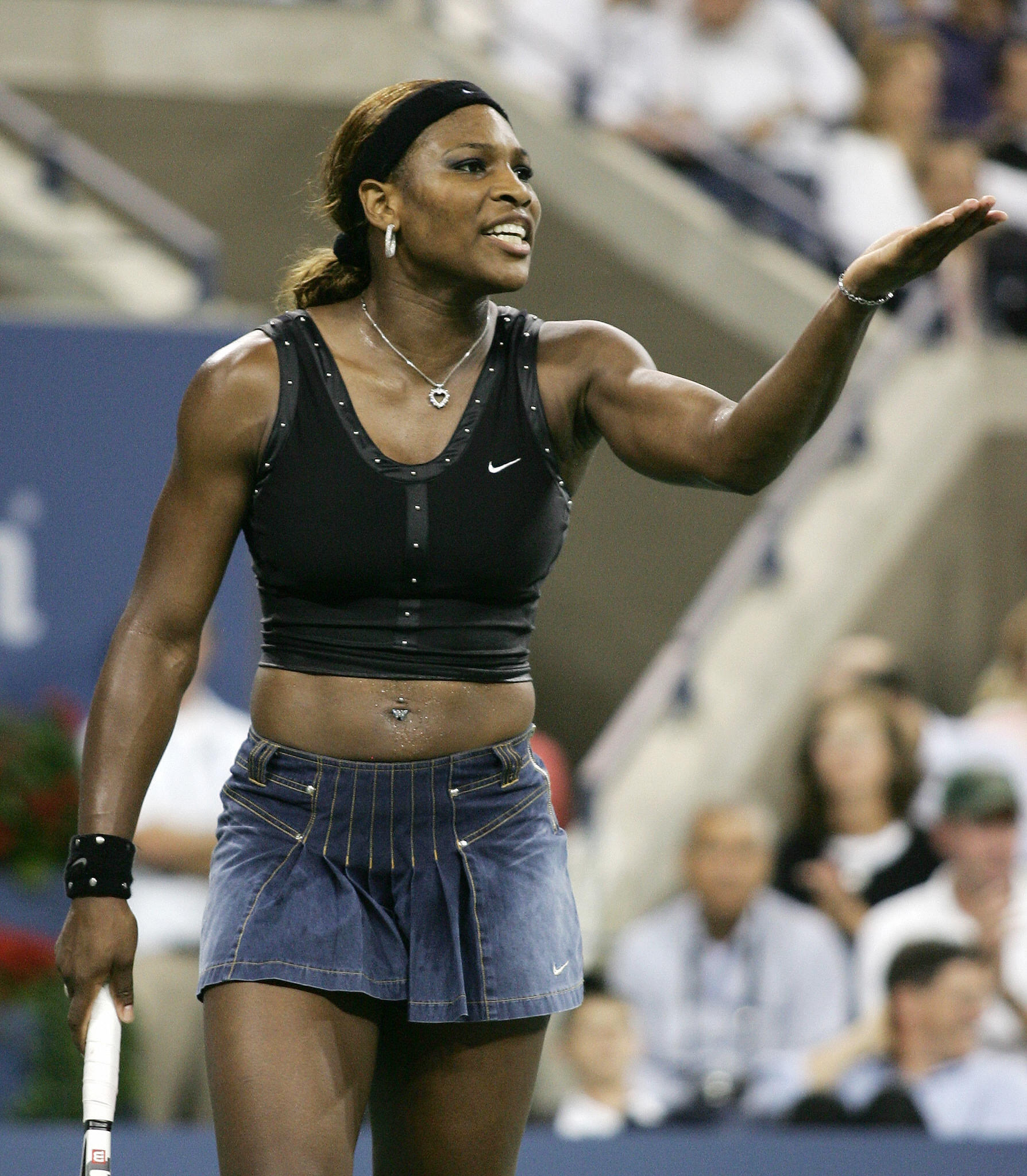 Only Serena Williams could pull off a black Nike top outlined in studs to the end of the shirt to reveal a stomach-baring midriff (check out those rockin' abs) and a denim skirt for the 2004 US Open.