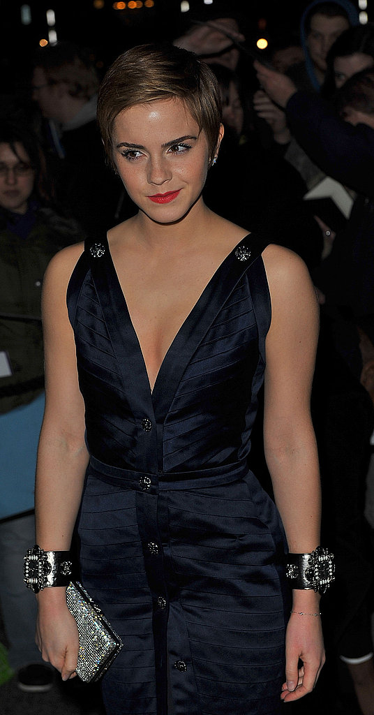 Emma Watson accessorized with a chunky bejeweled set in London, February 2011.