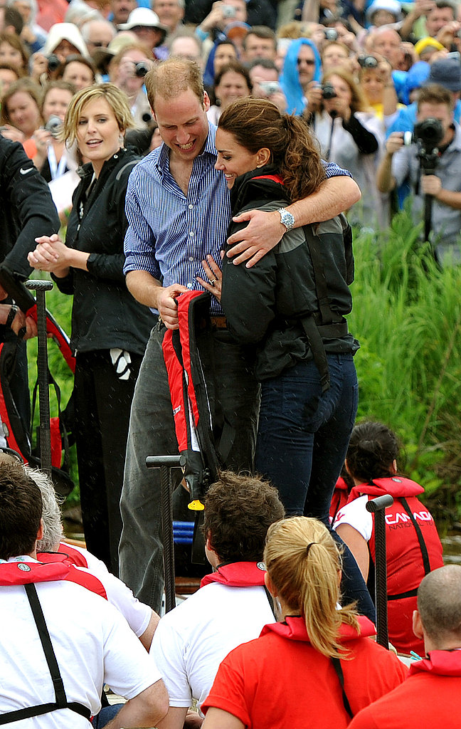 Prince William held Kate Middleton close.