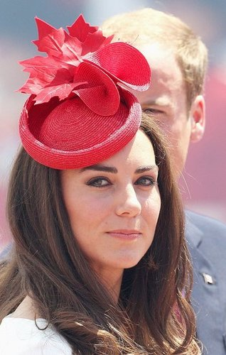 Kate Middleton paired her fascinator with jewelry reportedly borrowed from Queen Elizabeth.