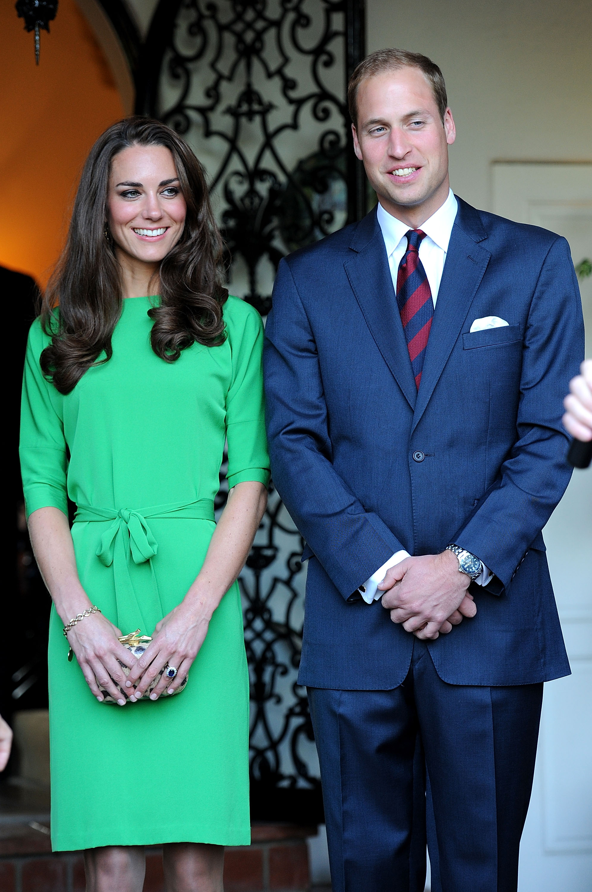 July 8th, 2011 At a private reception held at the British Consul-General's residence in Los Angeles, California.  Kate wears an emerald green, silk-belted Maja dress by Diane Von Furstenberg. Her leopard hard-cased clutch is also Diane von Furstenberg.