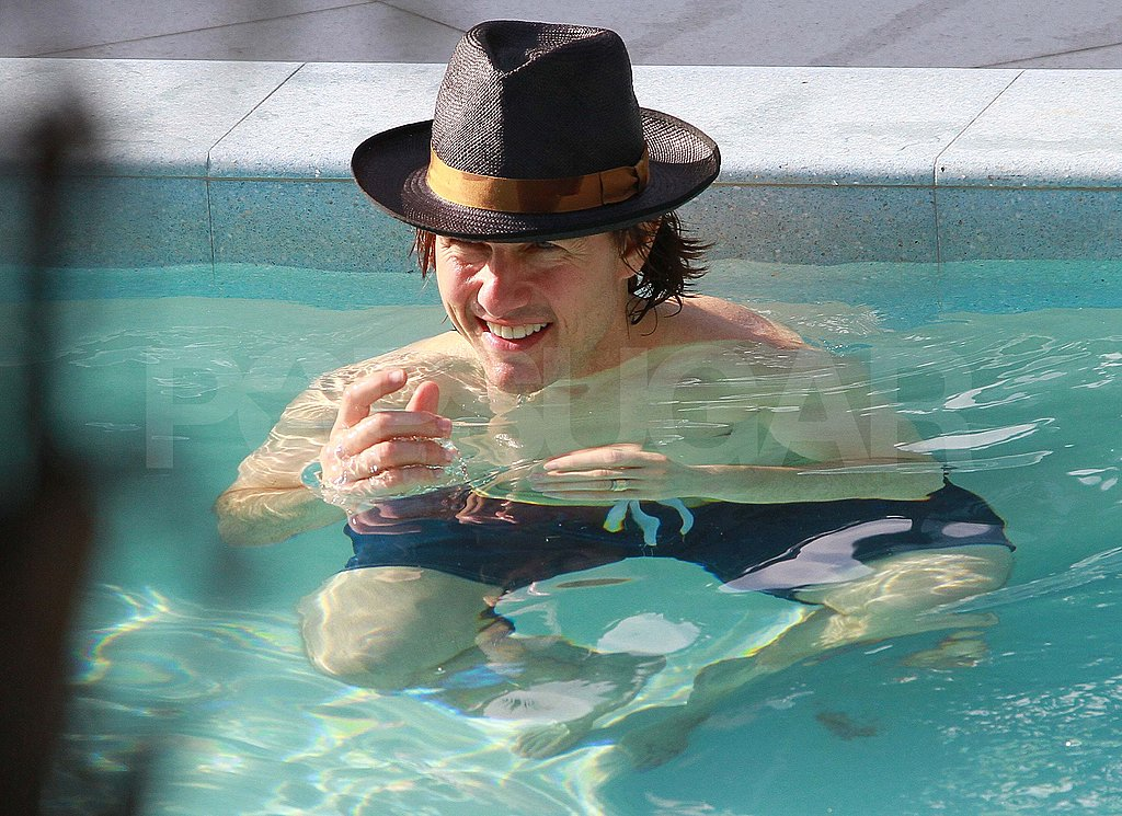 Tom Cruise shirtless in the pool in Miami.