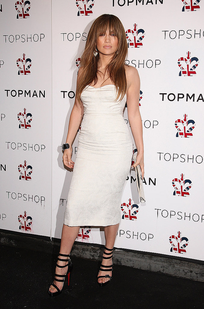 Stepping out for a Topshop event in a white strapless and statement footwear in 2009.
