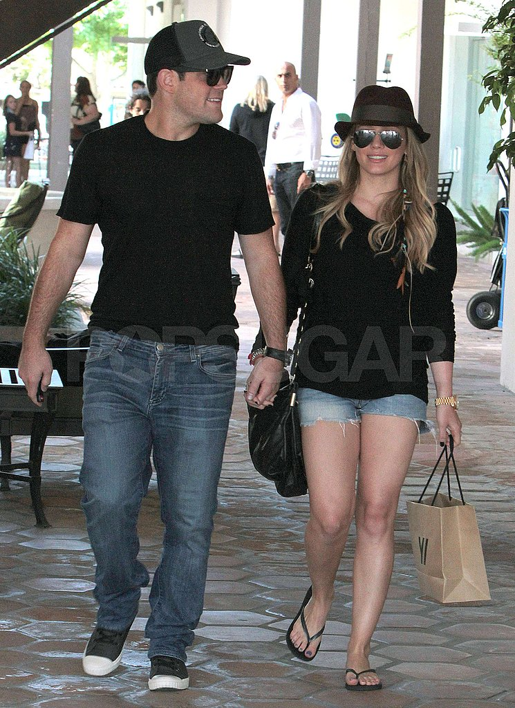 Hilary and Mike walked hand in hand.
