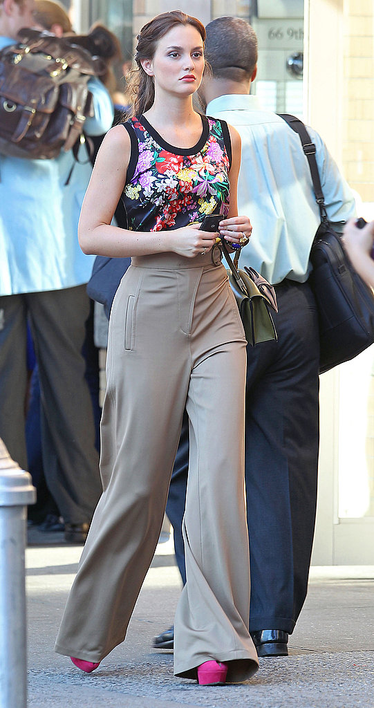 Leighton rocked her high waisted pants and bright pink pumps.
