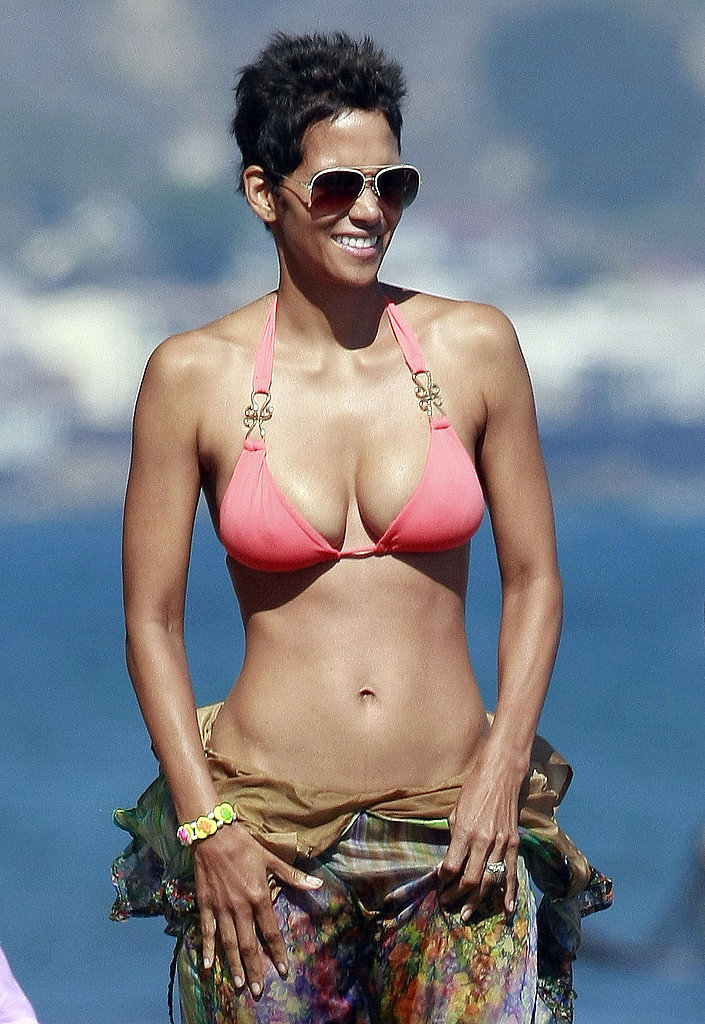 At 48, she looks better than any of us in a bikini.