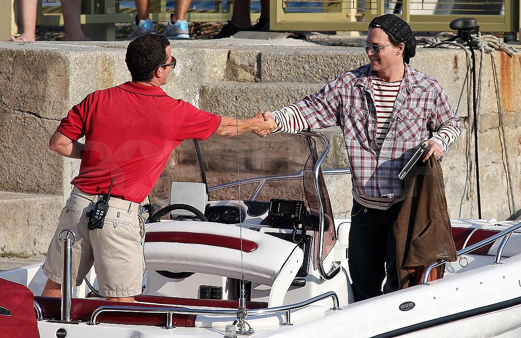 Johnny Depp shook hands with a boat captain.