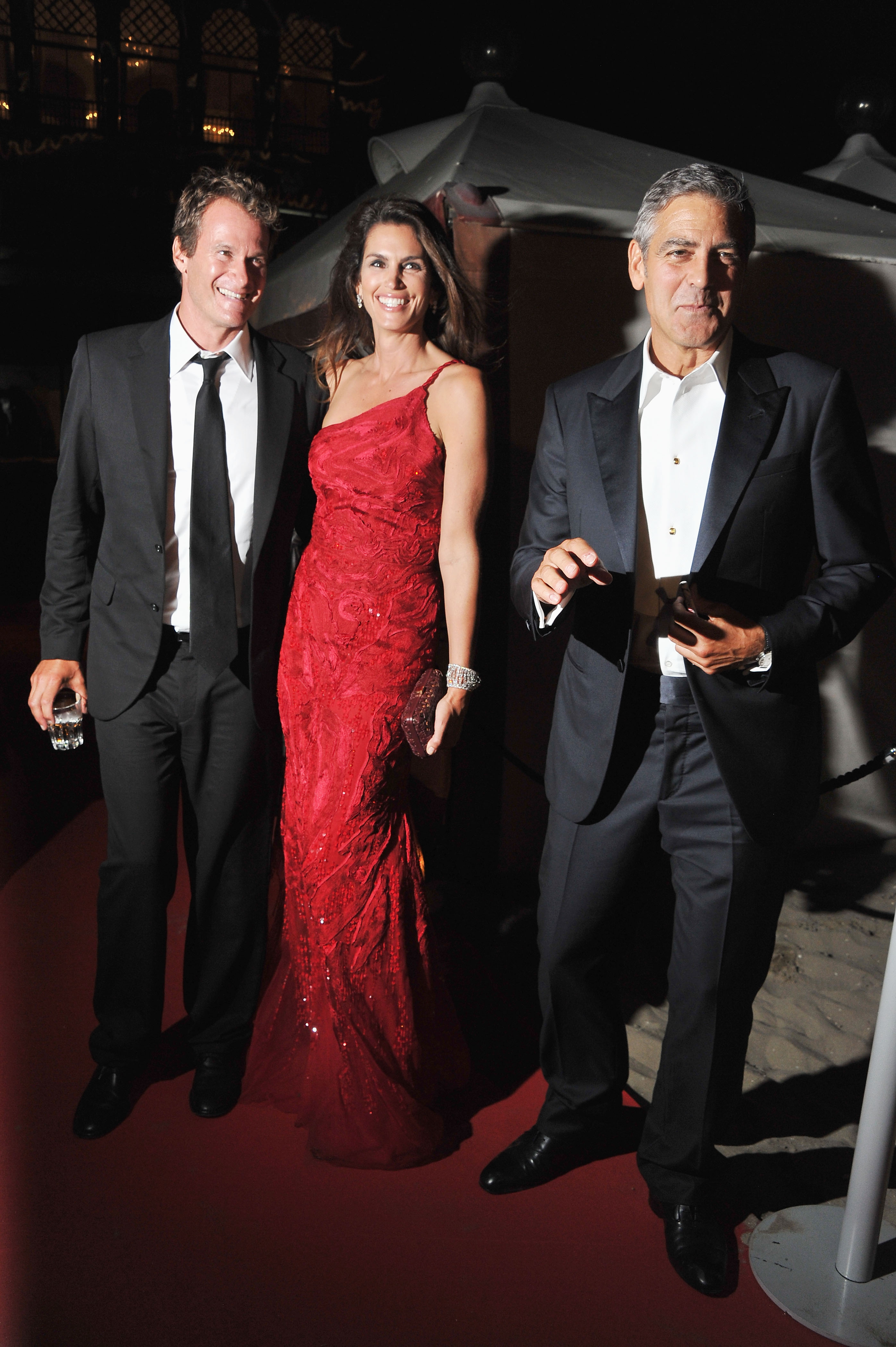 George Clooney with Rande Gerber and Cindy Crawford at the Venice Film Festival opening dinner.