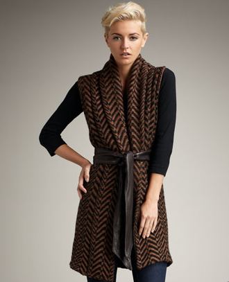 A chic take on the classic wrap sweater vest — with a cool leather belt.  Elizabeth and James Herringbone Shawl Vest ($295)