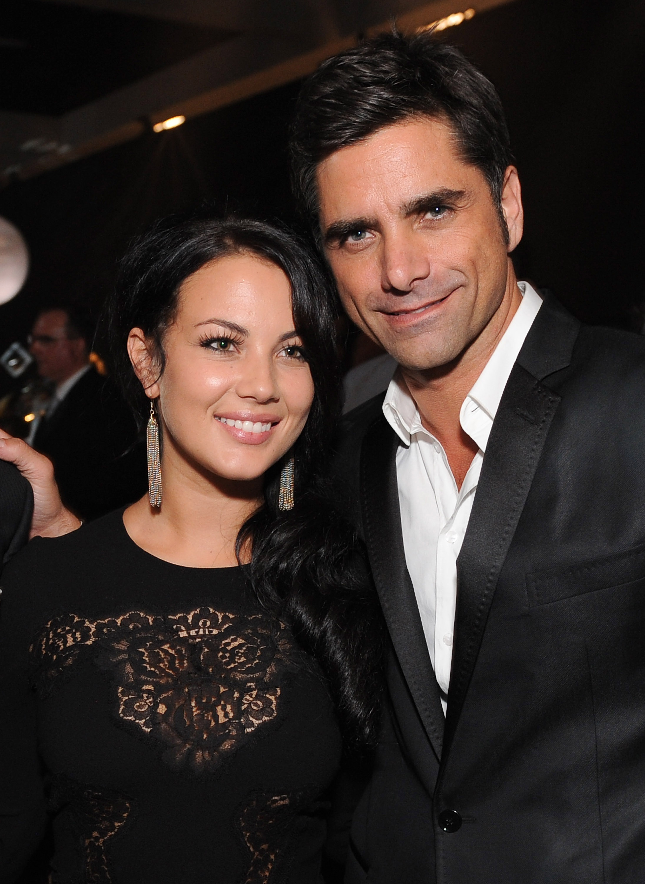John Stamos brings a guest to the Emmy's Governor's Ball.