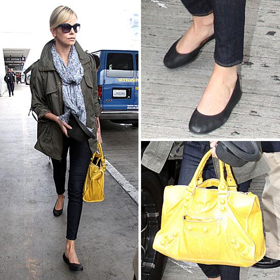 Charlize Theron Carrying a Yellow Balenciaga Bag