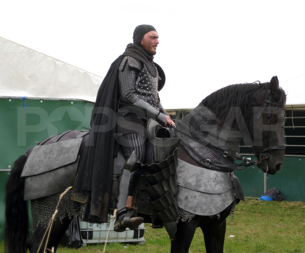 A man rides a horse on the Welsh set of Snow White and the Huntsman.