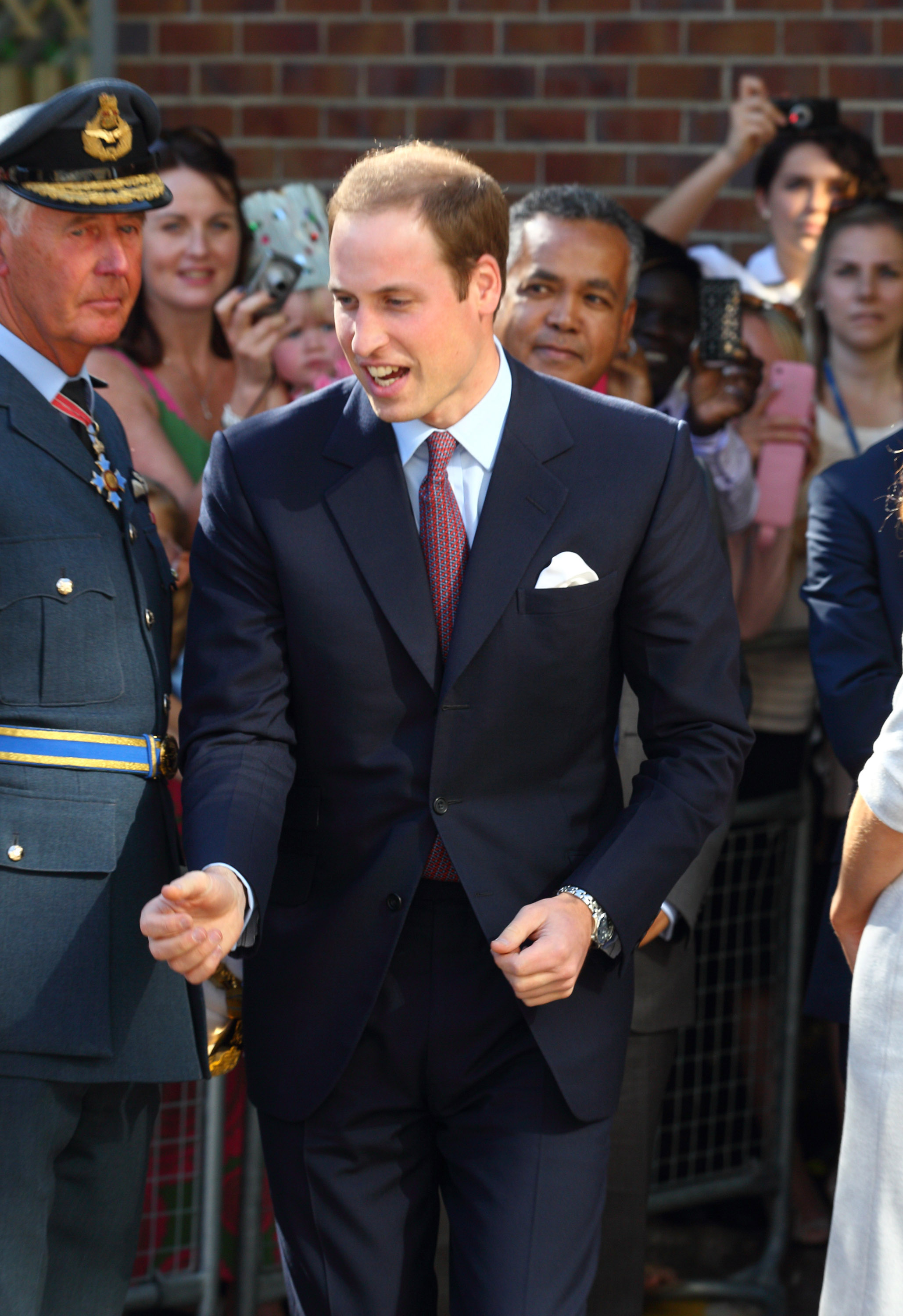 Prince William in a navy blue suit.