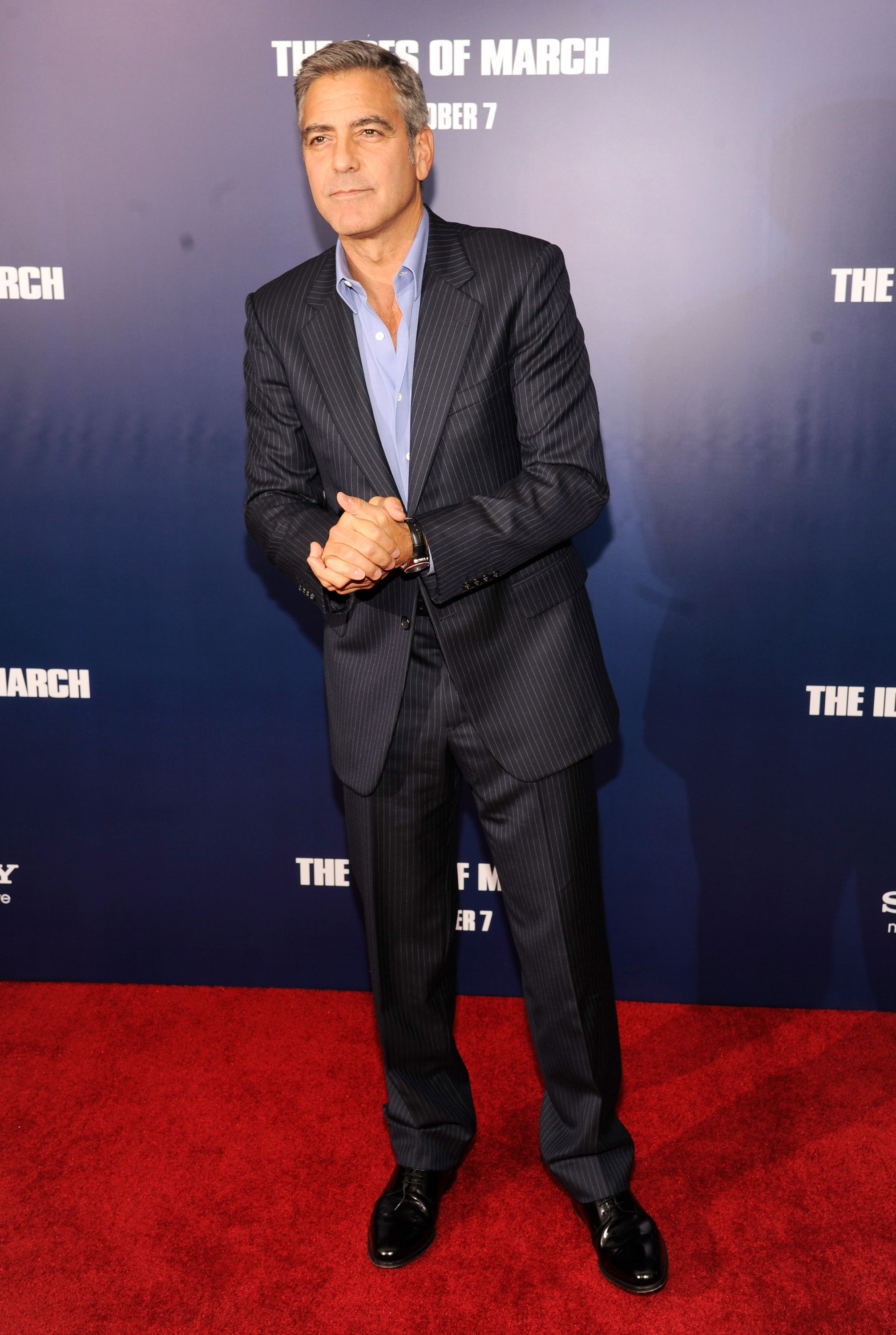 George clooney wore a crisp blue suit at the premiere of the ides of