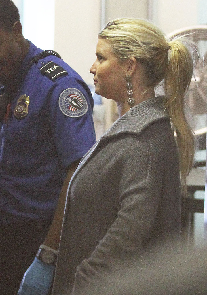 Jessica Simpson made her way through security.