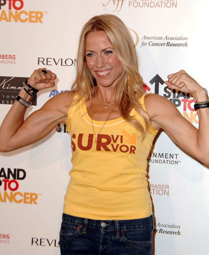 """In 2011, Sheryl Crow shared the silver lining of her 2006 breast cancer diagnosis: """"Anyone who's diagnosed with anything will agree that such news is not only a showstopper but also an opportunity to recreate the way you live and how you look at life. It was for me."""""""