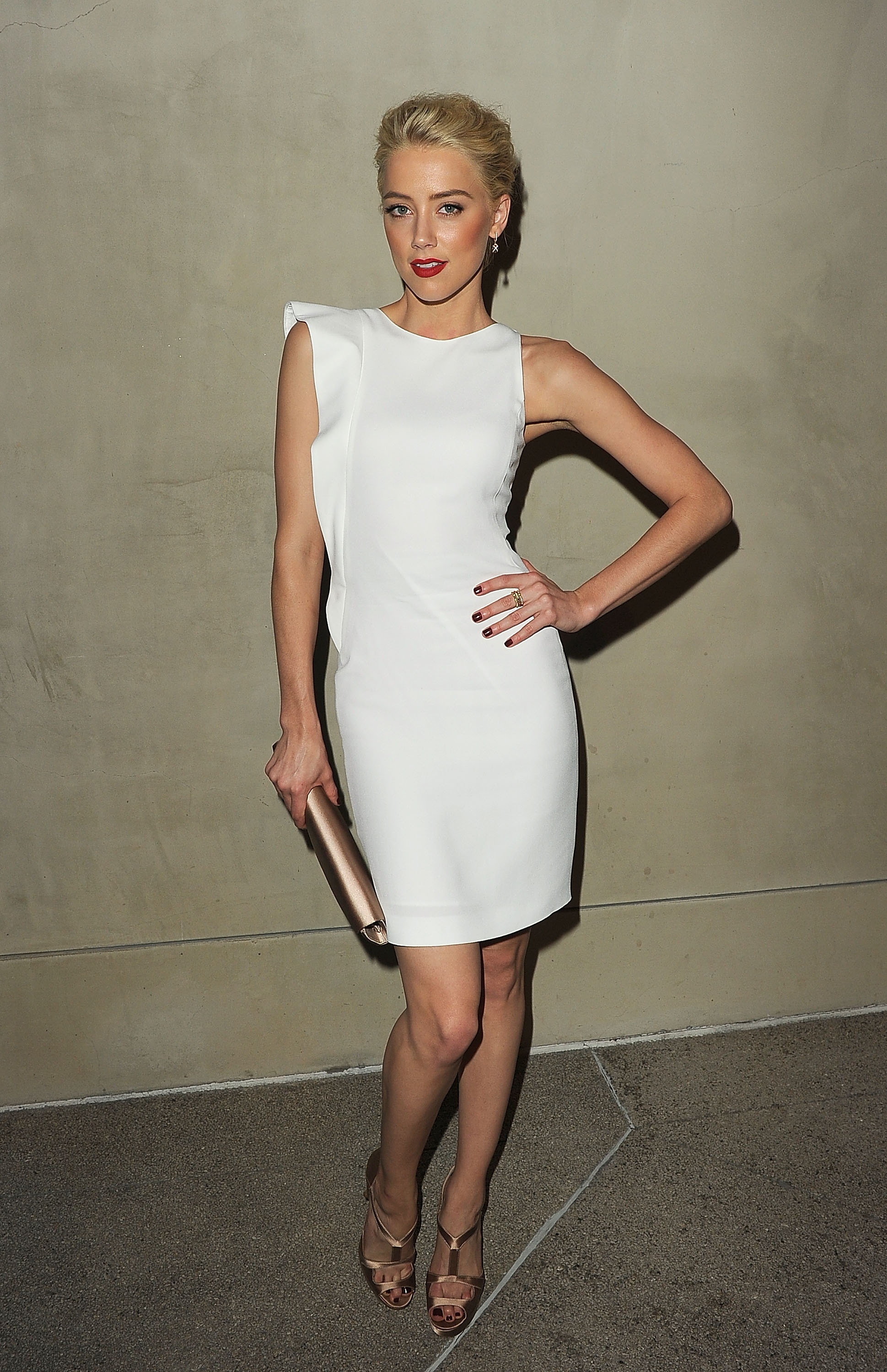 Amber Heard wore Armani to a dinner for the brand in LA.