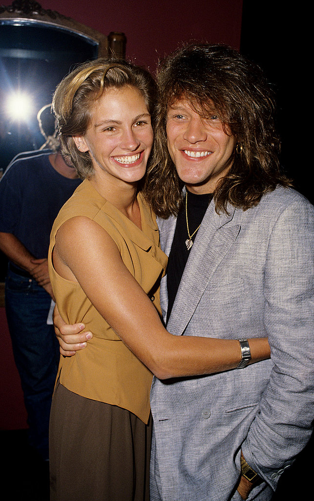 She gave Jon Bon Jovi a squeeze at the Young Guns II premiere in July 1990.