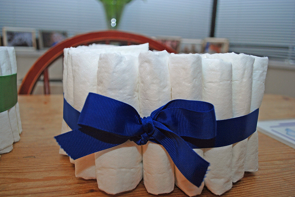 Fill with folded diapers, the same way you created the bottommost layer.