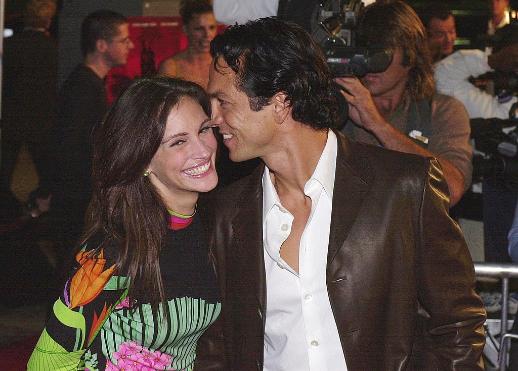 Julia shared a sweet red-carpet moment with Benjamin Bratt at the Red Planet premiere in 2000.