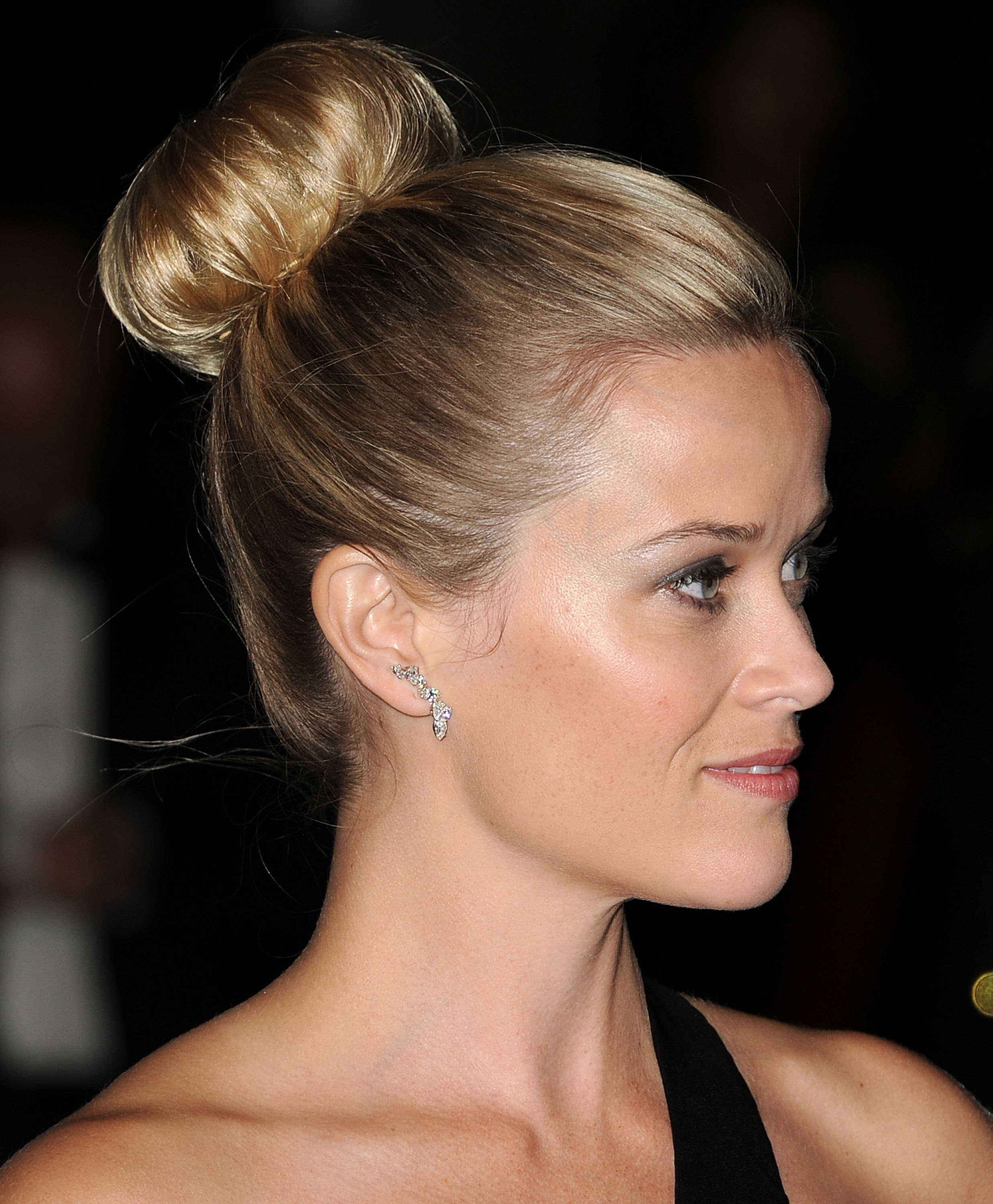 Reese Witherspoon with her hair in a big bun.