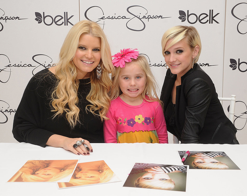 Jessica Simpson and Ashlee Simpson with a young fan at the NC launch of Jessica Simpson Girls.