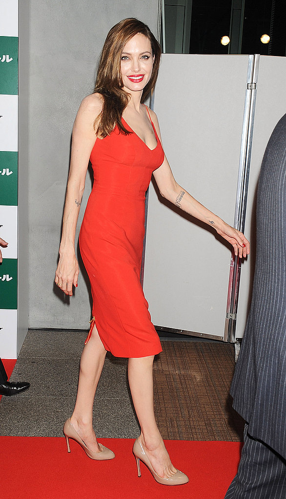 Angelina Jolie wowed in a red dress with red lips to match.
