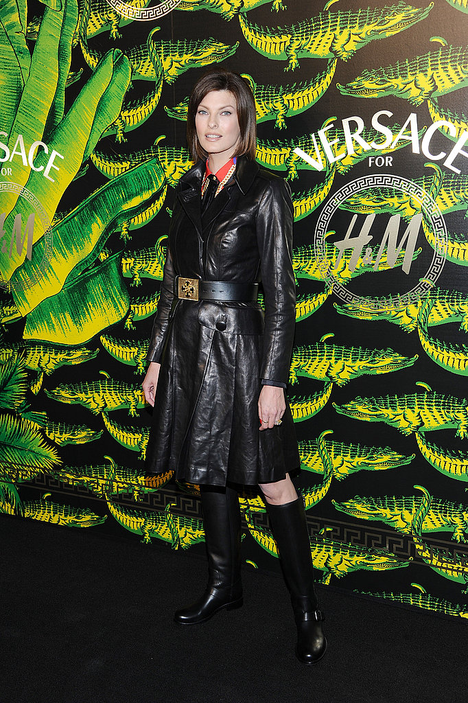 Linda Evangelista vamped up her Versace look for a fashion show.