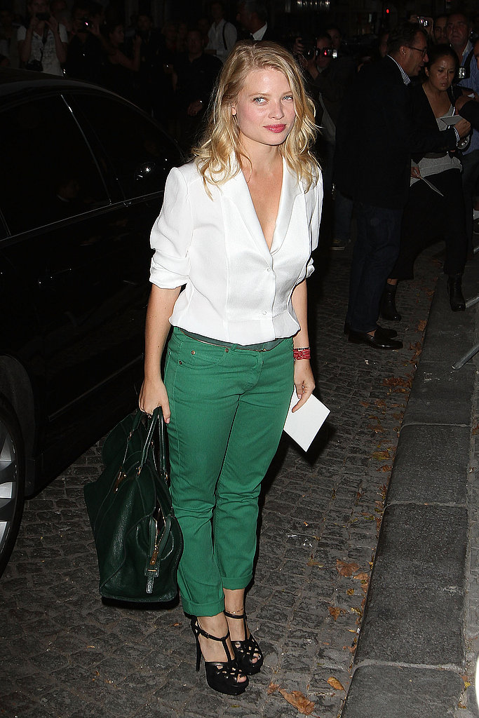 Actress Melanie Thierry's richly hued pants make a crisp counter to a white button-down.