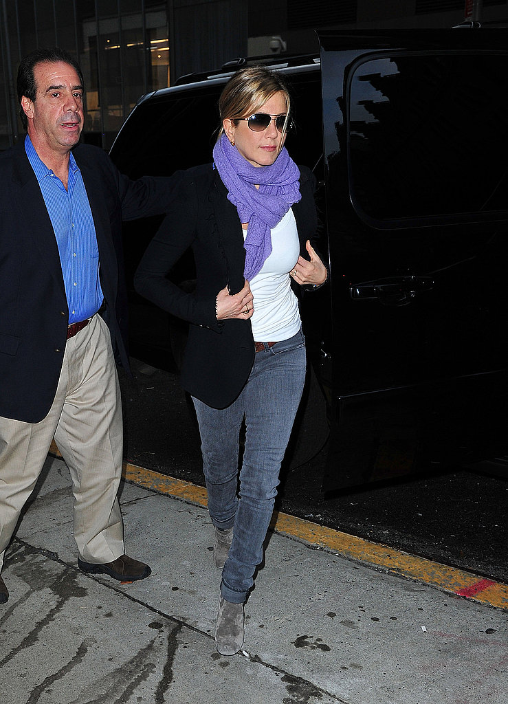 Jennifer Aniston wore grey suede booties in NYC.