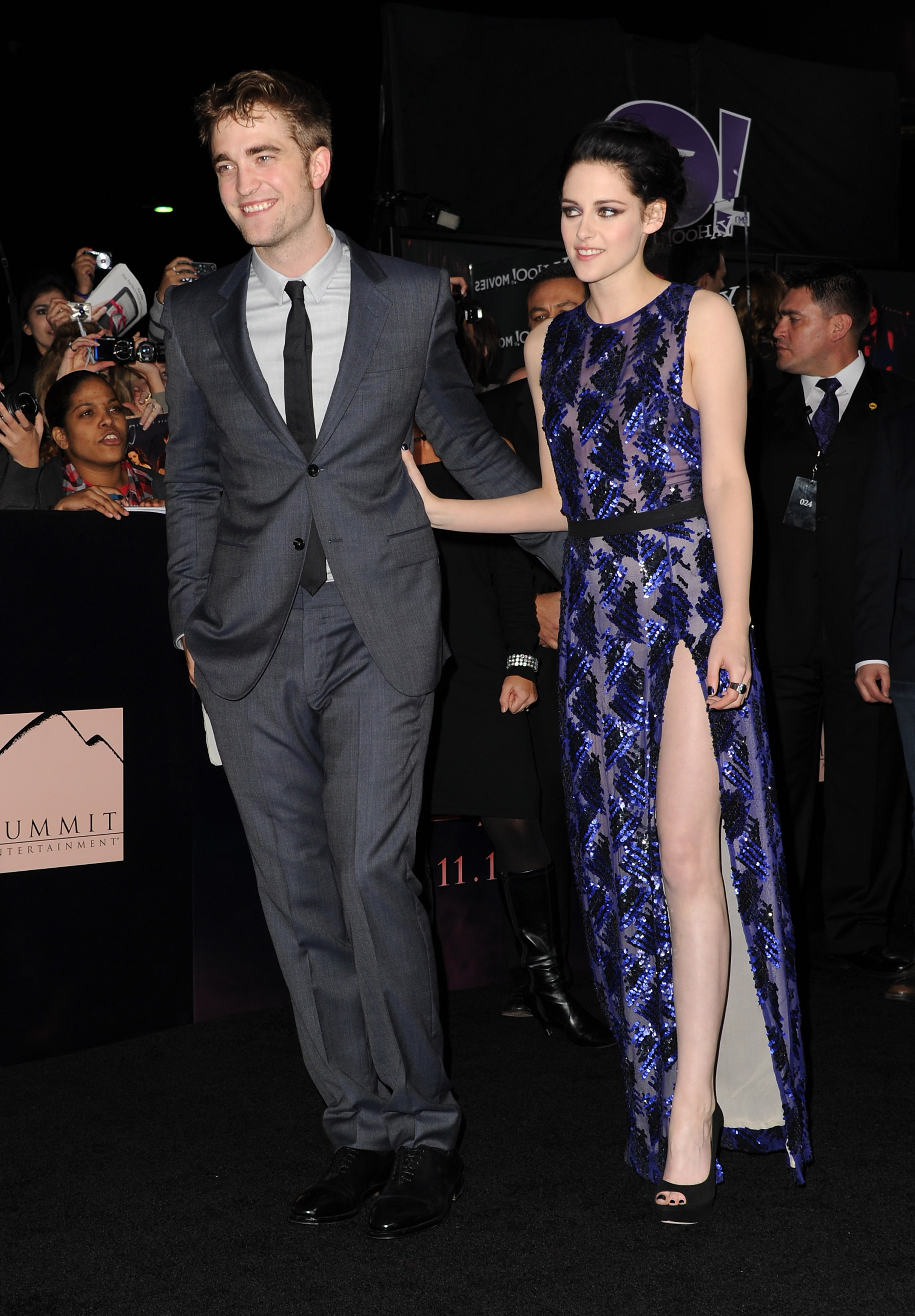 Kristen Stewart put her hand on Robert Pattinson's back while on the black carpet.
